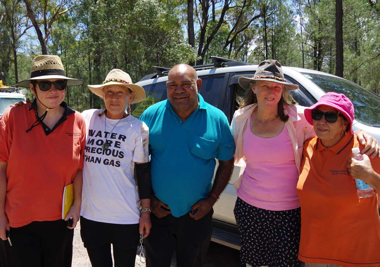 Jo Birtus and Jen Philips at Leewood, Pilliga Forest, with DEG Chairperson Clem Dodd shortly after the women released by police, with DEG staff Wendy Spencer and Kim Sullivan