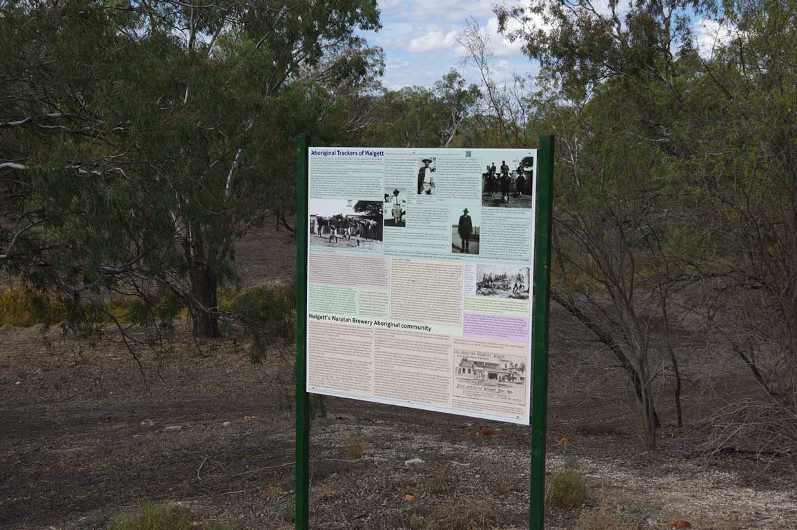 Sign offering information about Walgett Aboriginal trackers and the brewery community, located at the entrance to the Tracker Walford Walkway